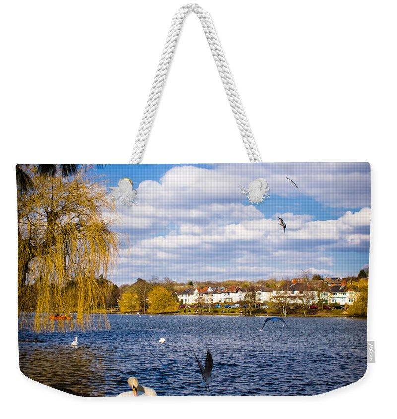 Beak Weekender Tote Bag featuring the photograph Roath Park Lake by Mark Llewellyn