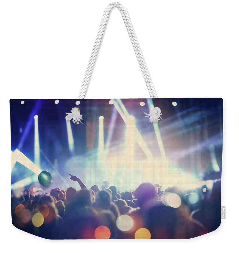 Event Weekender Tote Bag featuring the photograph Rock Concert by Gilaxia