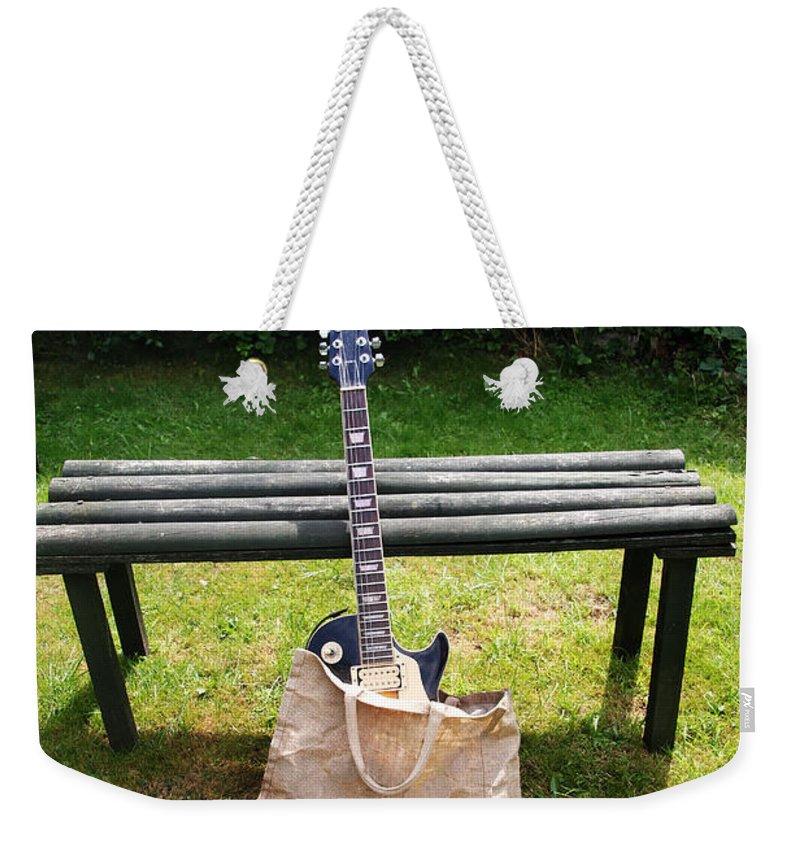 Guitar Weekender Tote Bag featuring the photograph Rock N Roll Guitar In A Bag by Tom Conway