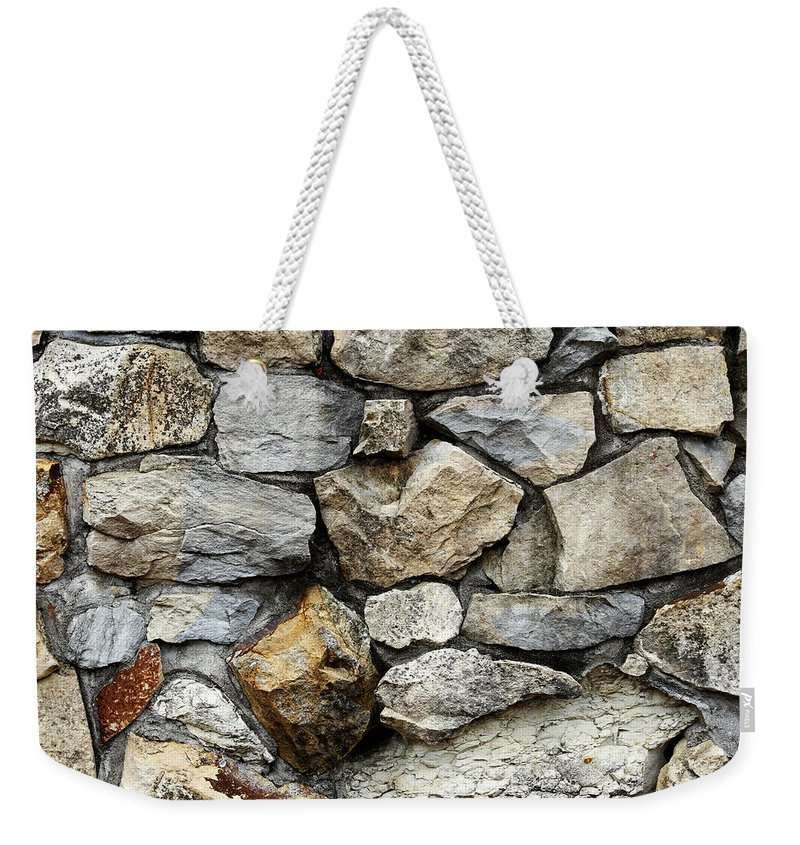Surface Weekender Tote Bag featuring the photograph Rock Wall by Les Cunliffe