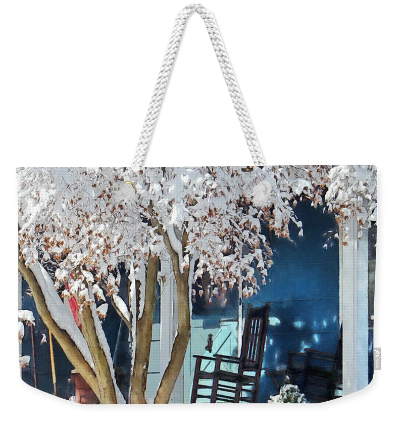 Rocking Chair Weekender Tote Bag featuring the photograph Rocking Chair On Porch In Winter by Susan Savad