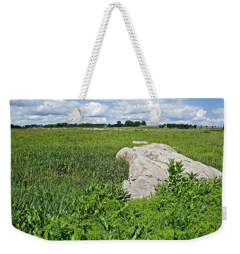 Rocks In A Tall Grass Prairie In Pipestone National Monument Weekender Tote Bag featuring the photograph Rocks In A Tall Grass Prairie In Pipestone National Monument-minnesota by Ruth Hager