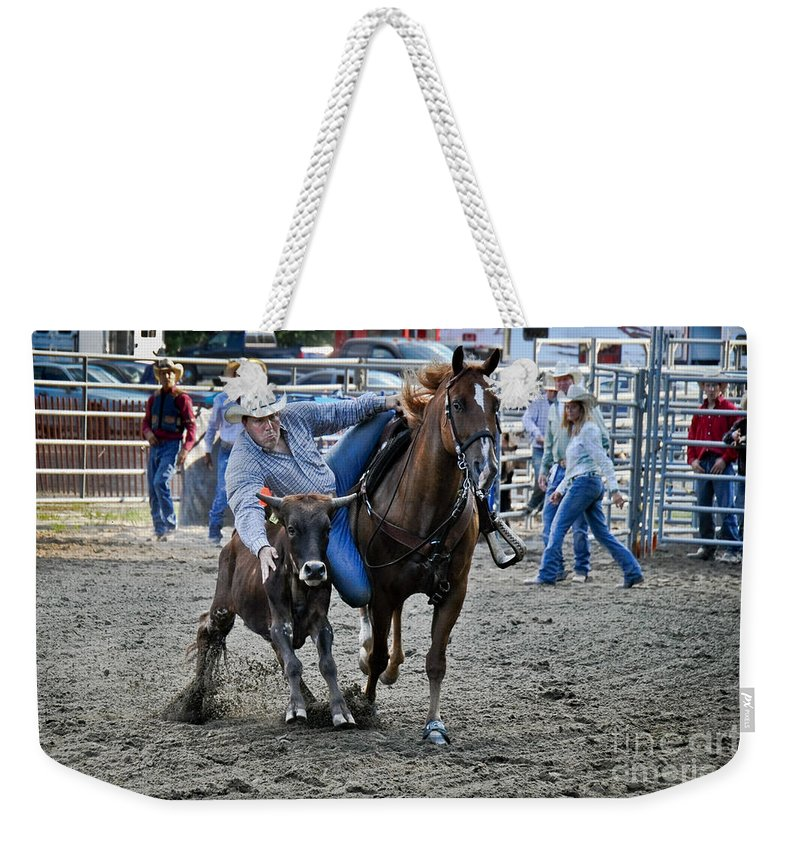 Cowboy Weekender Tote Bag featuring the photograph Rodeo Bulldog by Gary Keesler