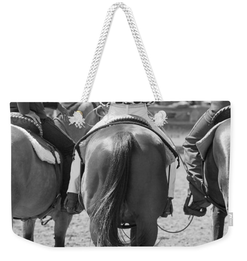 Rodeo Weekender Tote Bag featuring the photograph Rodeo Bums by Michelle Wrighton