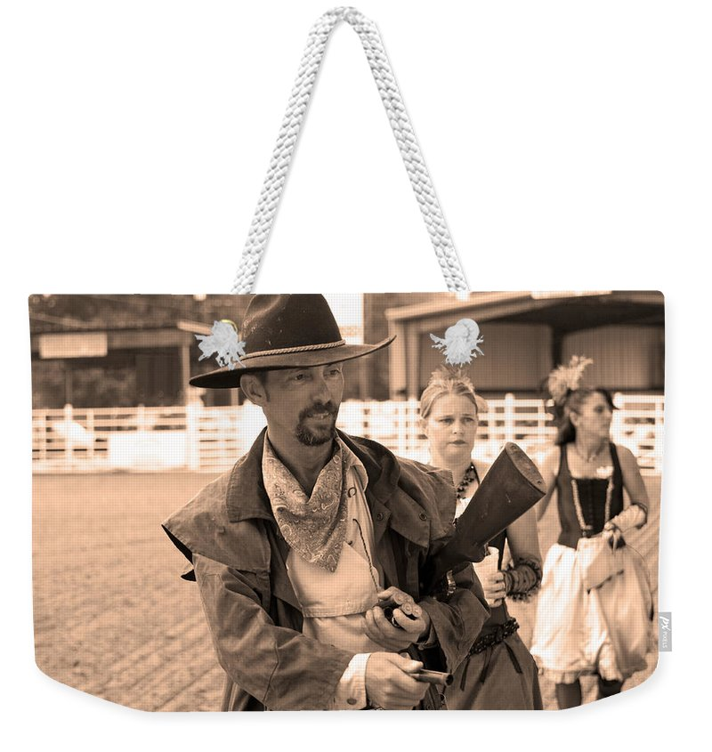 Rodeo Weekender Tote Bag featuring the photograph Rodeo Gunslinger With Saloon Girls Sepia by Sally Rockefeller