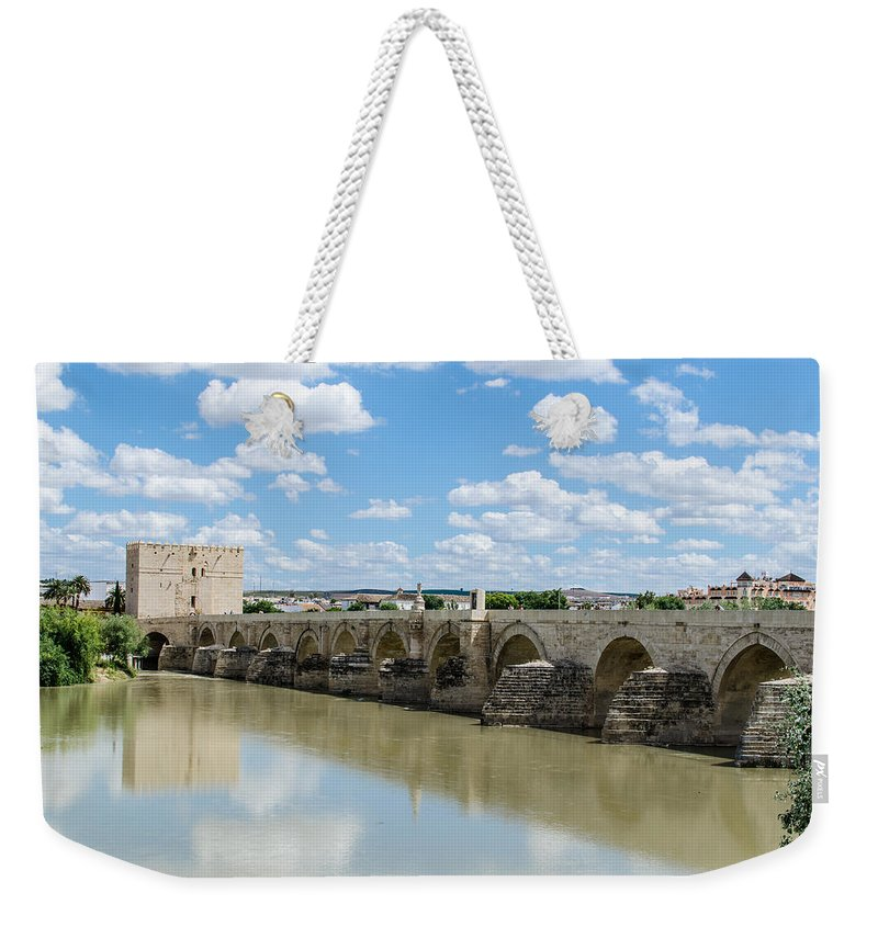 Roman Weekender Tote Bag featuring the photograph Roman Bridge Of Cordoba by Andrea Mazzocchetti