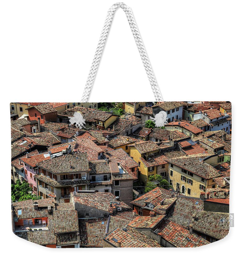 Tranquility Weekender Tote Bag featuring the photograph Roofs by Mento