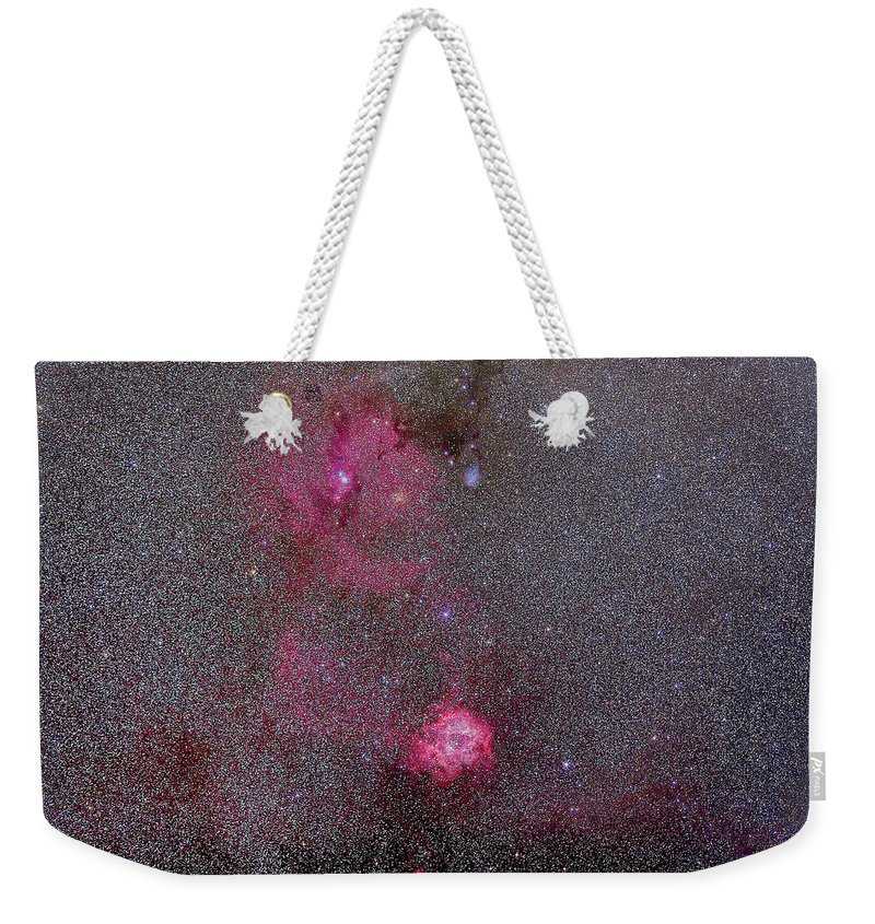 135mm Telephoto Lens Weekender Tote Bag featuring the photograph Rosette And Cone Nebula Area by Alan Dyer