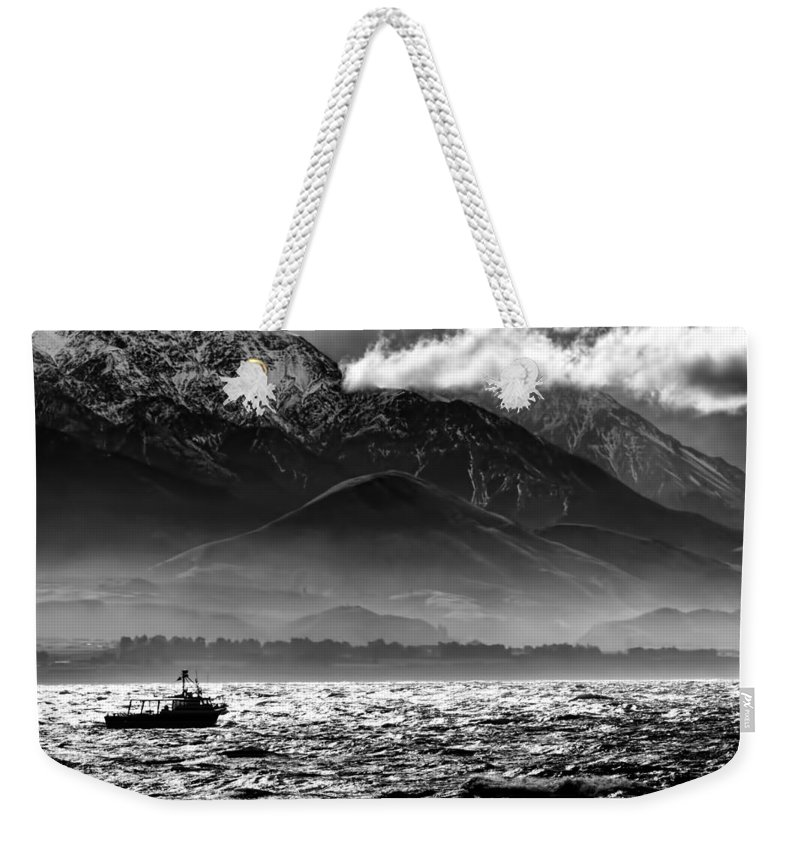 Rough Sea Weekender Tote Bag featuring the photograph Rough Seas Kaikoura New Zealand In Black And White by Amanda Stadther