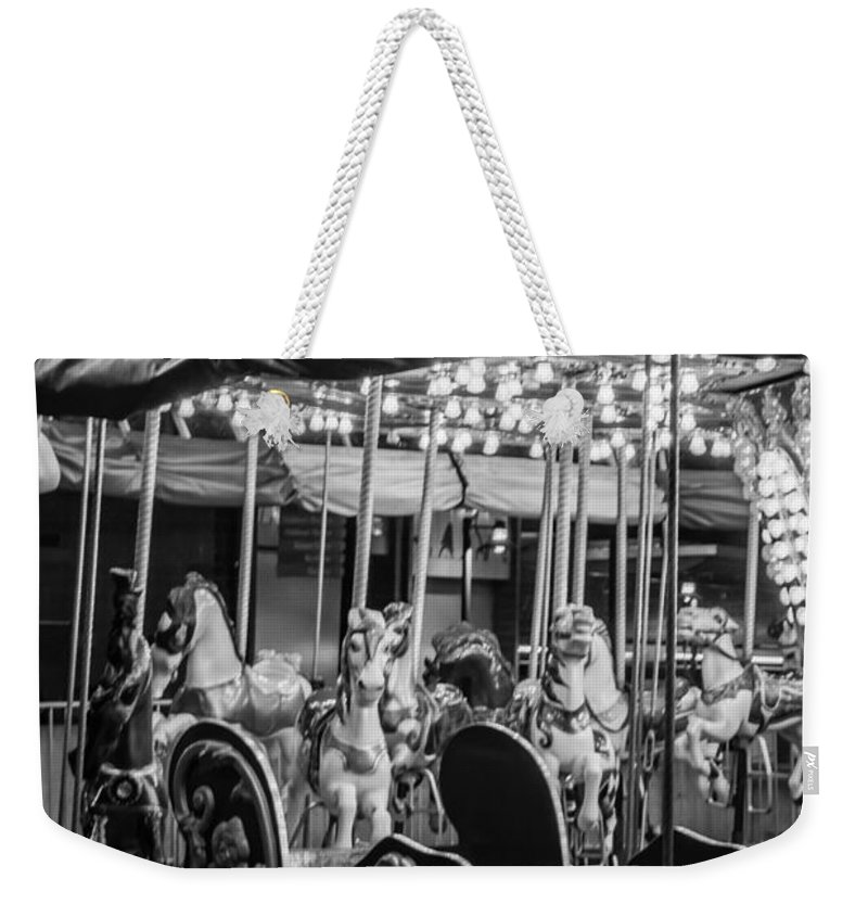 2008 Weekender Tote Bag featuring the photograph Round We Go by Melinda Ledsome