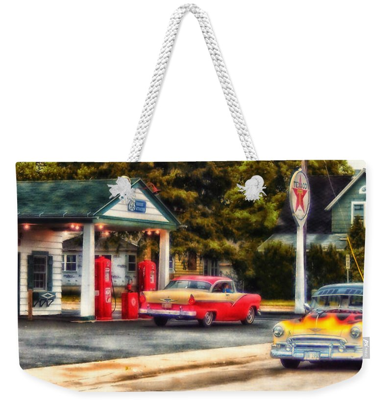 Transportation Weekender Tote Bag featuring the photograph Route 66 Historic Texaco Gas Station by Thomas Woolworth