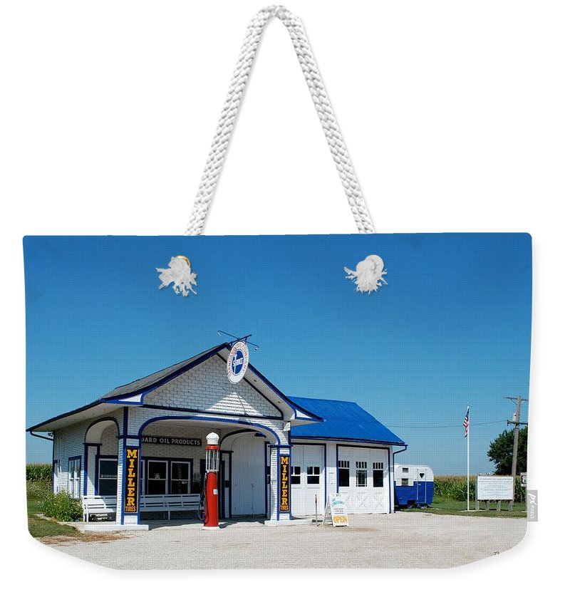 Red Weekender Tote Bag featuring the photograph Route 66 Odell Il Gas Station 02 by Thomas Woolworth