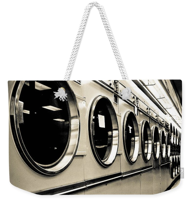 B&w Weekender Tote Bag featuring the photograph Row Of Washing Machines In Laundromat by Amy Cicconi