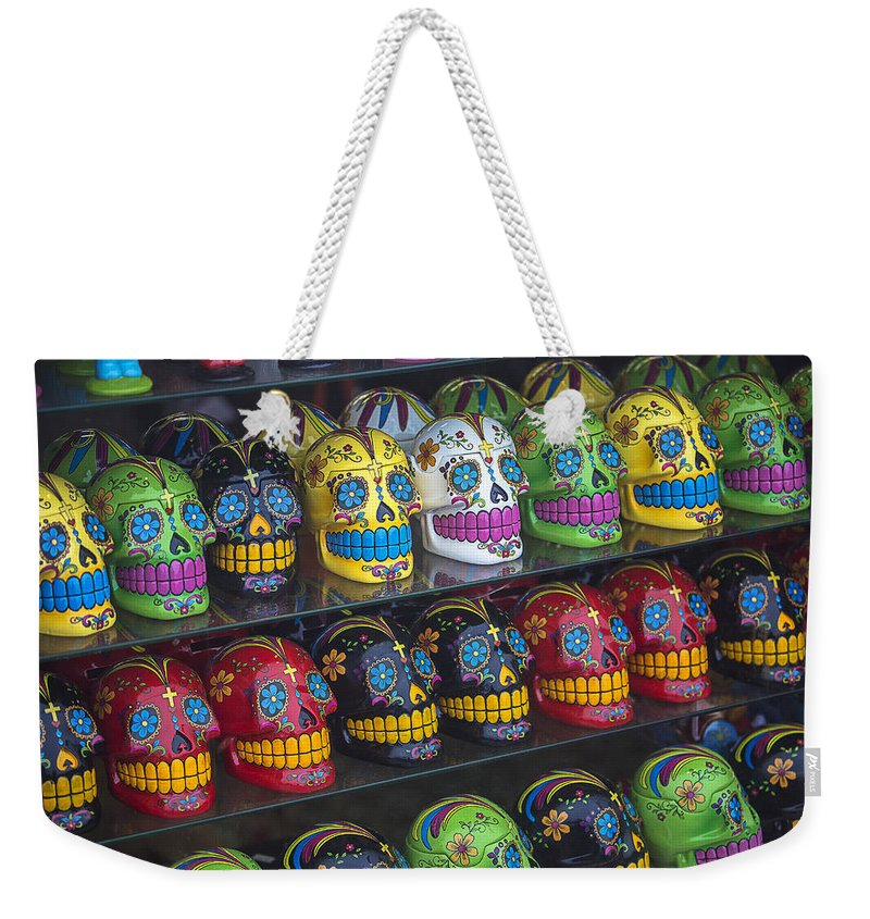 Rows. Row Weekender Tote Bag featuring the photograph Rows Of Skulls by Garry Gay