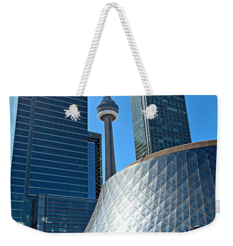 Toronto Weekender Tote Bag featuring the photograph Roy Thomson Hall And Cn Tower by Paul Fell