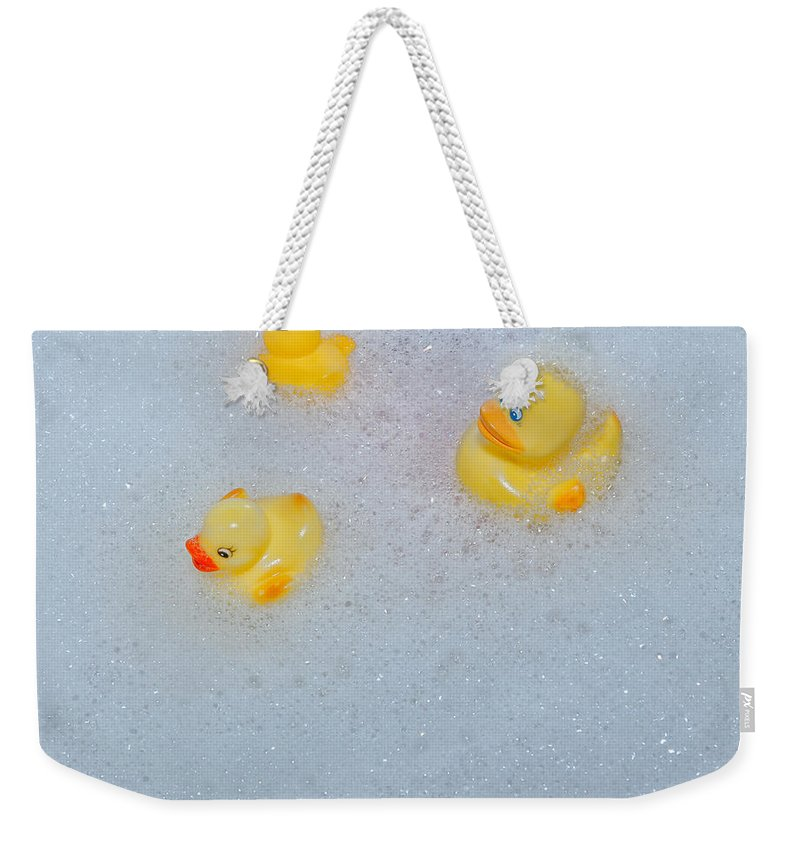 Duck Weekender Tote Bag featuring the photograph Rubber Ducks by Joana Kruse