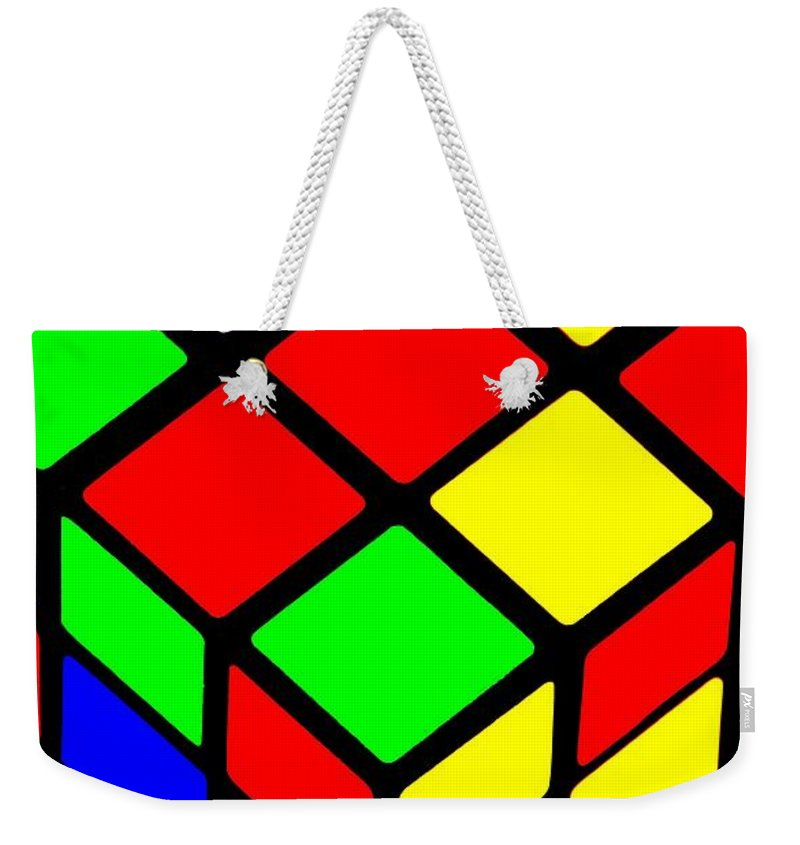 Iphone Weekender Tote Bag featuring the photograph Rubik's Phone by Benjamin Yeager