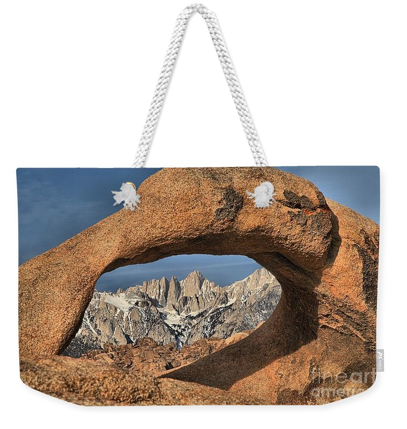Mobius Arch Weekender Tote Bag featuring the photograph Rugged Peaks Through Mobius by Adam Jewell