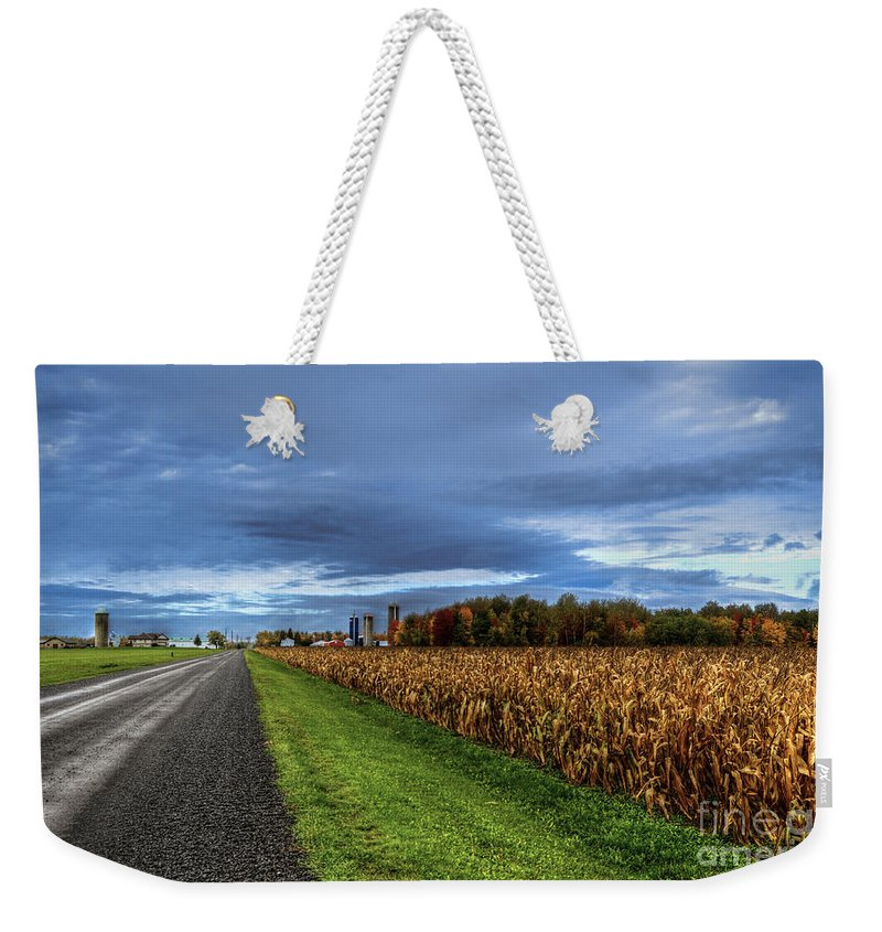 Rural Weekender Tote Bag featuring the photograph Rural Drama.. by Nina Stavlund