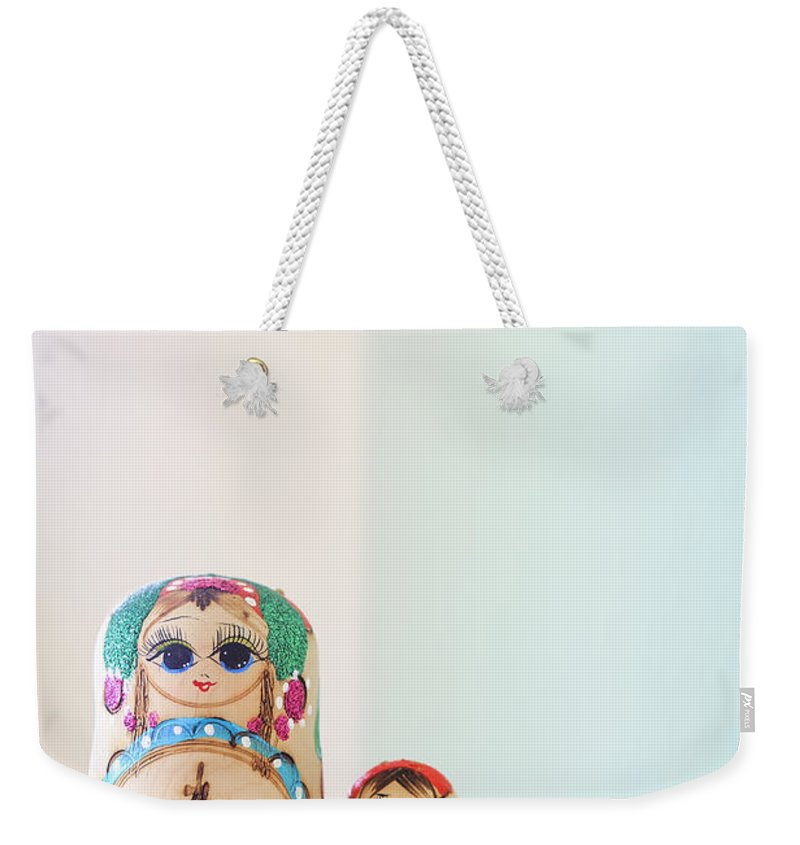 Russian Weekender Tote Bag featuring the photograph Russian Dolls by Evelina Kremsdorf