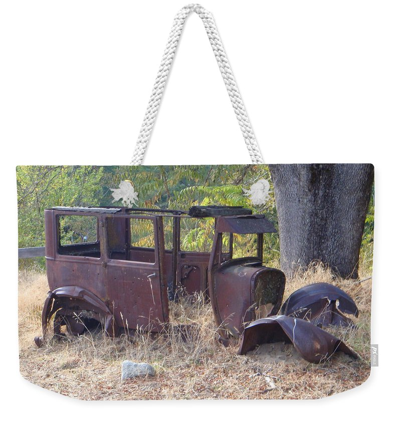 Ford Weekender Tote Bag featuring the photograph Rust In Full Bloom by Mary Deal
