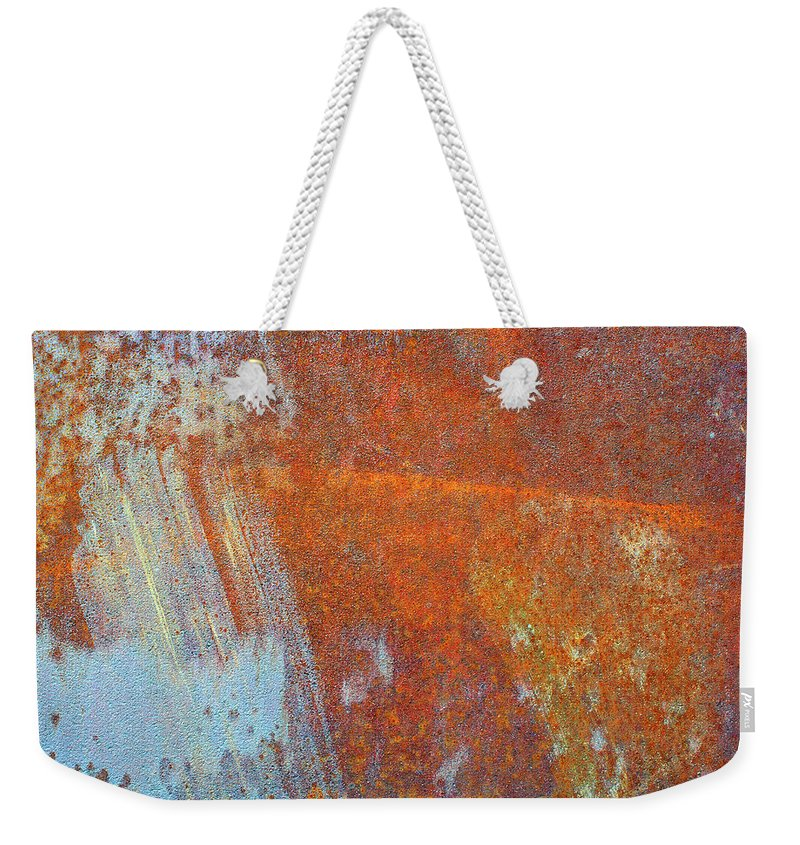 Aging Process Weekender Tote Bag featuring the photograph Rust On A Metal Surface by Rob Atkins
