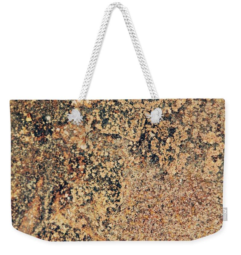 Rust Weekender Tote Bag featuring the photograph Rusted Metal by Dan Radi