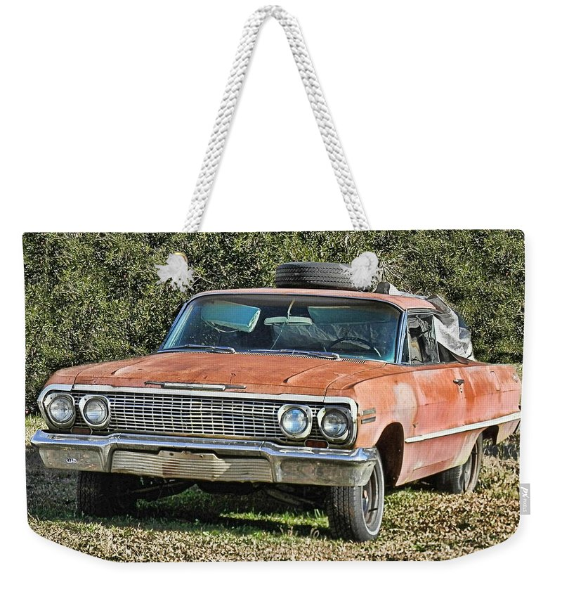 Victor Montgomery Weekender Tote Bag featuring the photograph Rusty Impala by Victor Montgomery
