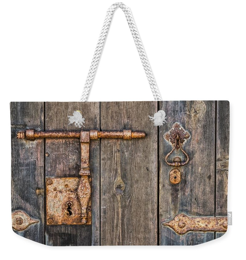 Aged Weekender Tote Bag featuring the photograph Rusty Key-hole by Paulo Goncalves