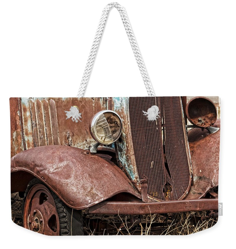 Rusty Old Chevy Weekender Tote Bag featuring the photograph Rusty Old Chevy by Wes and Dotty Weber