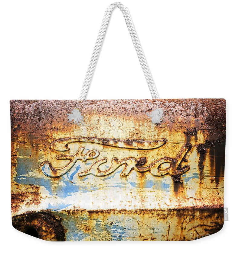 Ford Weekender Tote Bag featuring the photograph Rusty Old Ford Closeup by Edward Fielding