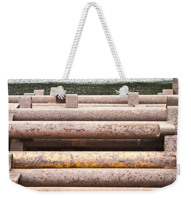 Abstract Weekender Tote Bag featuring the photograph Rusty Pipes by Tom Gowanlock