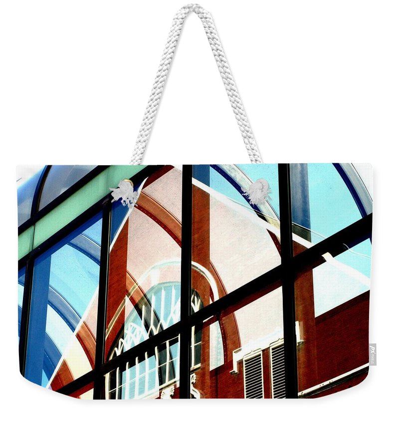 Pedestrian Wallway Weekender Tote Bag featuring the photograph Ryman by Joseph Yarbrough