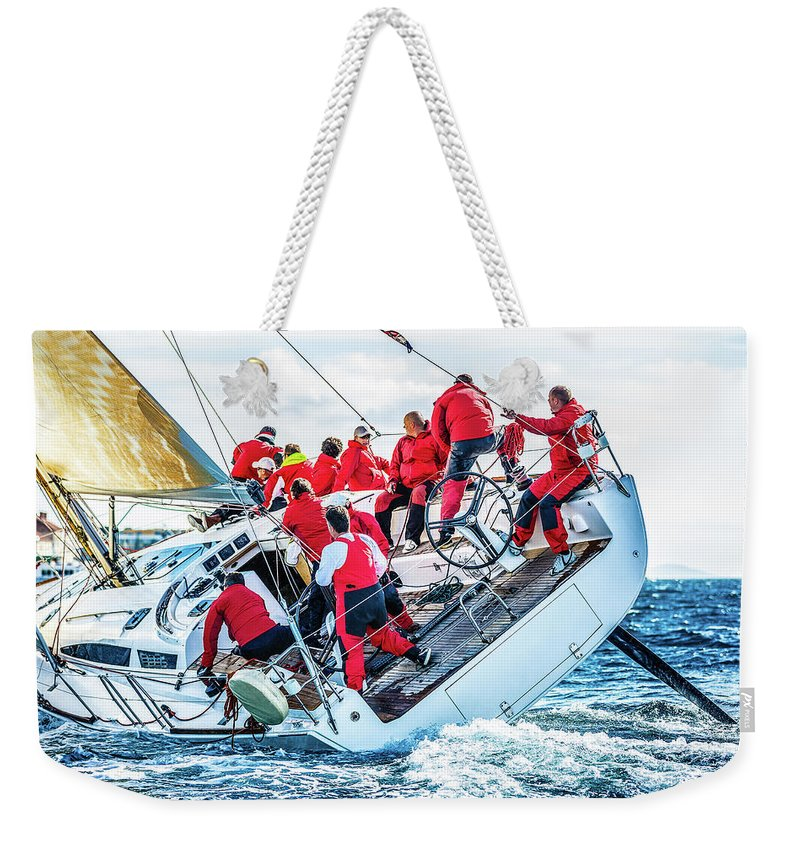 Adriatic Sea Weekender Tote Bag featuring the photograph Sailing Crew On Sailboat During Regatta by Mbbirdy