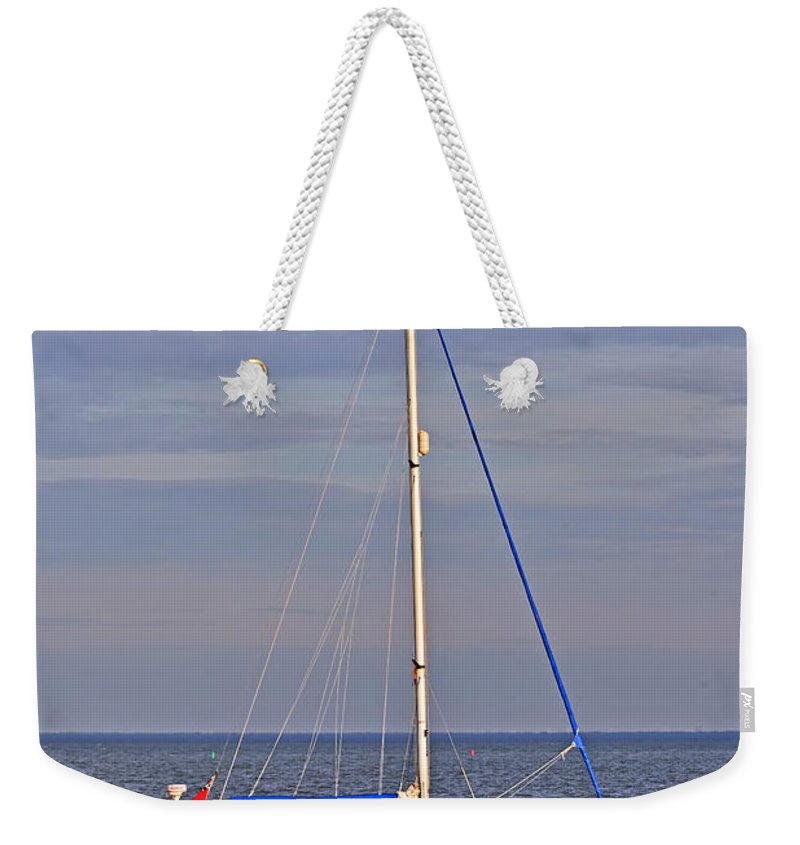 Travel Weekender Tote Bag featuring the photograph Sailing In Volendam by Elvis Vaughn