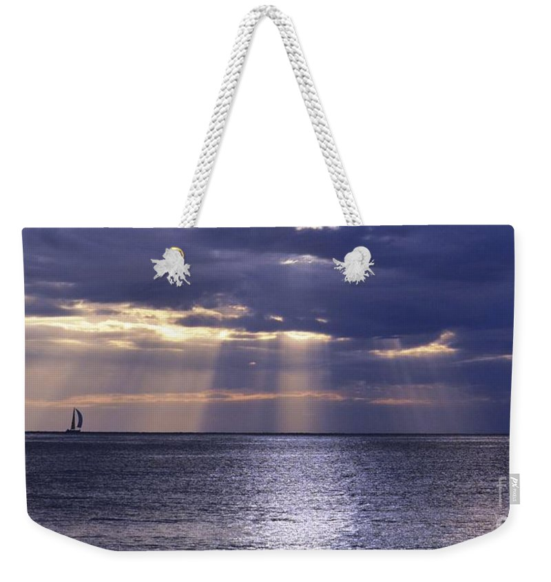 Sailing Weekender Tote Bag featuring the photograph Sailing Through The Sun Rays 2. by Alfie Borg