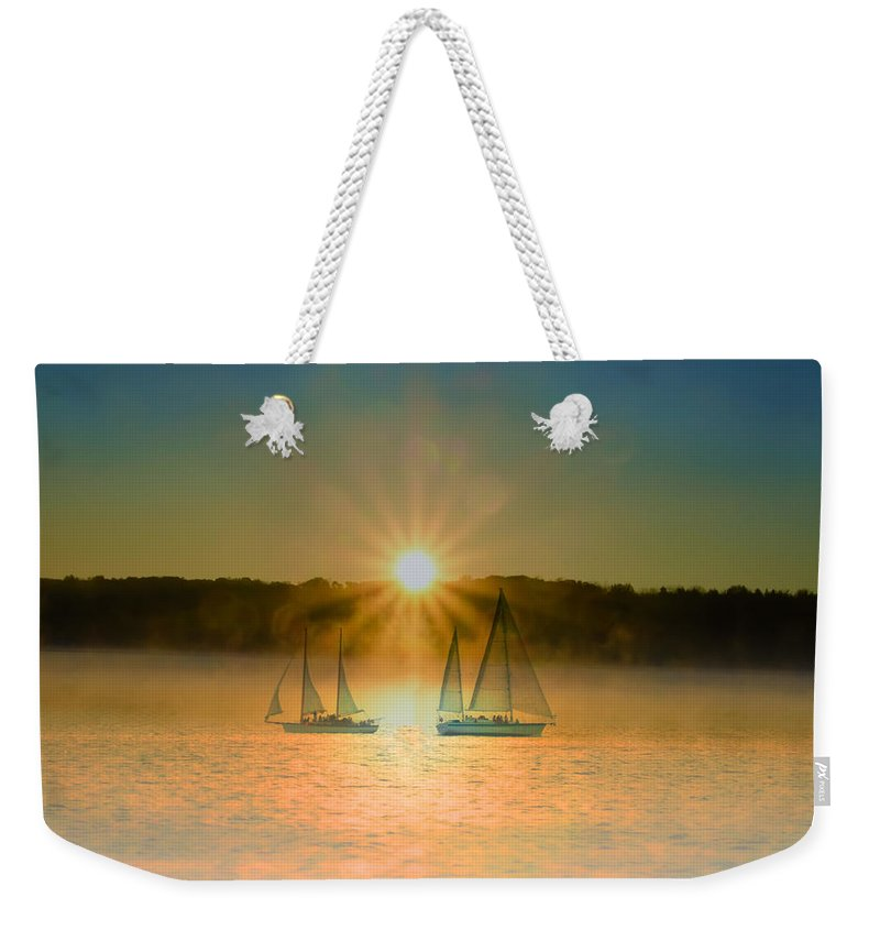 Sailing Weekender Tote Bag featuring the photograph Sailing When The Sun Comes Up by Bill Cannon