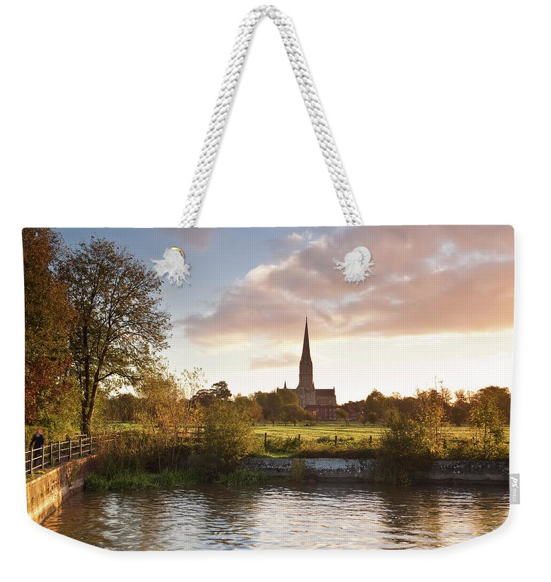 Tranquility Weekender Tote Bag featuring the photograph Salisbury Cathedral And The River Avon by Julian Elliott Photography