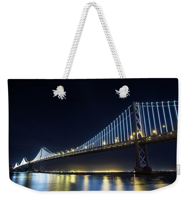 California Weekender Tote Bag featuring the photograph San Francisco Bay Bridge With Led Lights by Halbergman