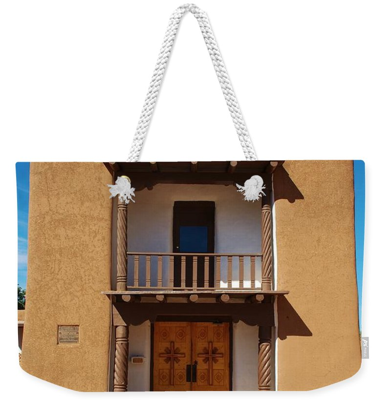 Taos Pueblo Weekender Tote Bag featuring the photograph San Geronimo Church by Dany Lison