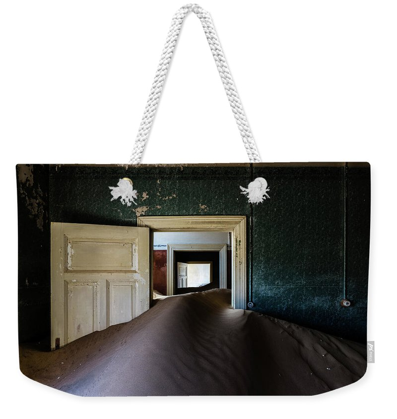 Sand Dune Weekender Tote Bag featuring the photograph Sand Dune In Door Frame Of Abandoned by Pixelchrome Inc