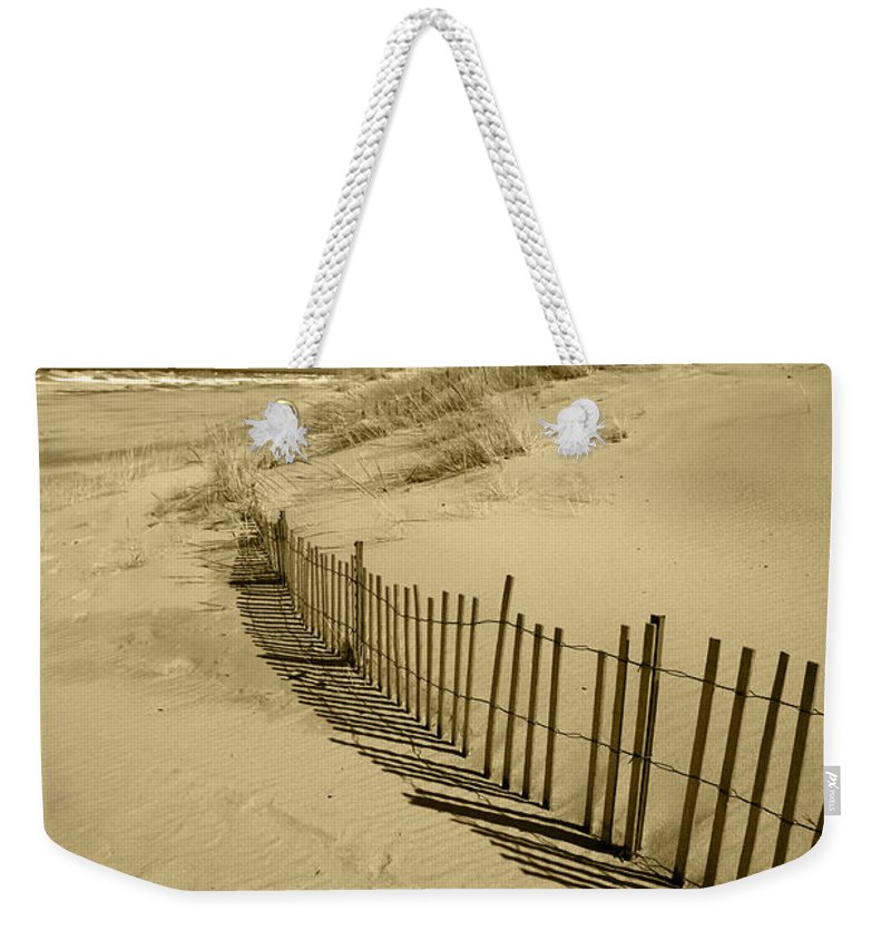 Sand Dunes Weekender Tote Bag featuring the photograph Sand Dunes and Fence by Timothy Johnson