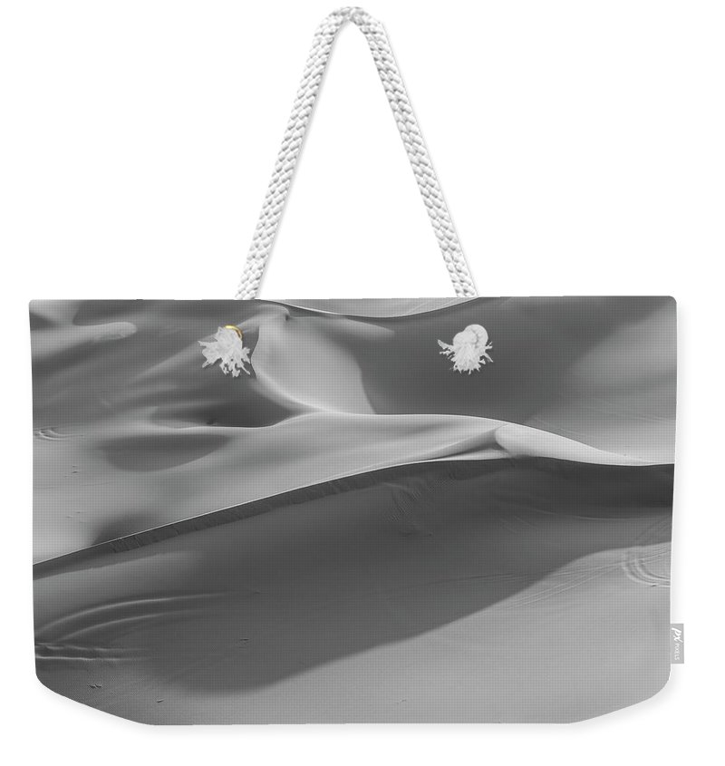 Sand Dune Weekender Tote Bag featuring the photograph Sand Dunes In The Desert, Monochrome by Moritz Wolf