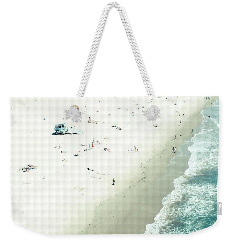 Water's Edge Weekender Tote Bag featuring the photograph Santa Monica Beach by Angela Auclair