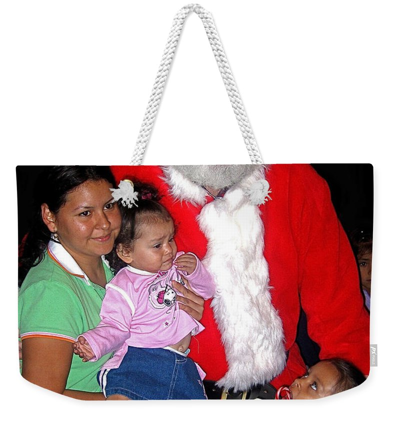 Santa Poses With Fans Annual Christmas Parade Eloy Arizona Hispanic Family Snoopy Shirt Weekender Tote Bag featuring the photograph Santa Poses With Fans At Annual Christmas Parade Eloy Arizona 2004 by David Lee Guss