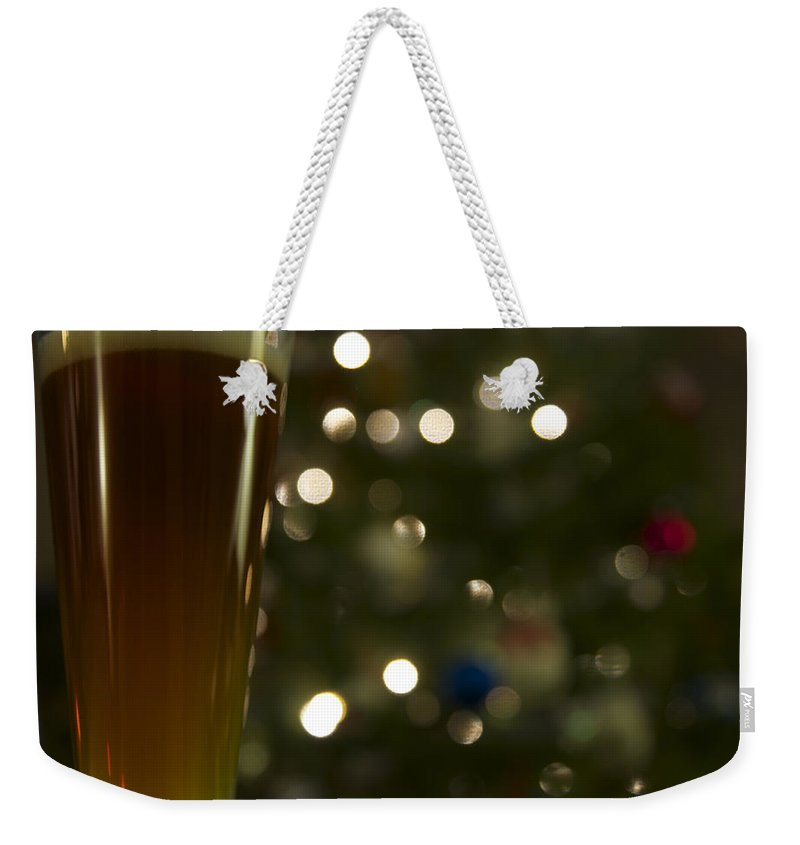 Matt Matekovic Weekender Tote Bag featuring the photograph Santas Gift by Photographic Arts And Design Studio