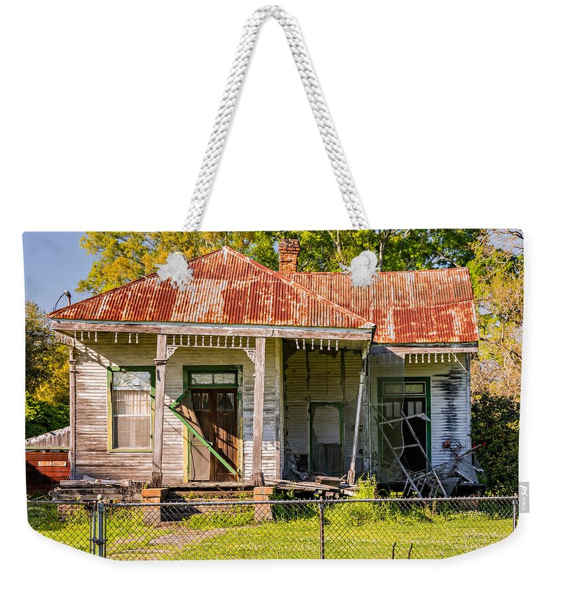 Building Weekender Tote Bag featuring the photograph Savage Katrina 3 by Steve Harrington
