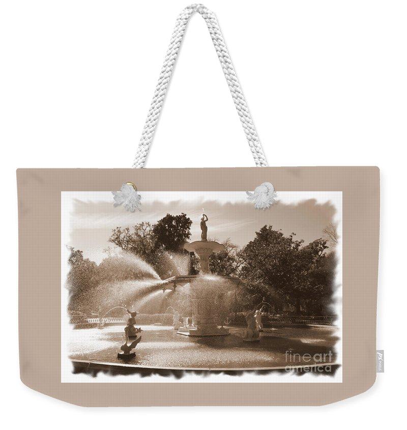 Savannah Fountain Weekender Tote Bag featuring the photograph Savannah Fountain In Sepia by Carol Groenen