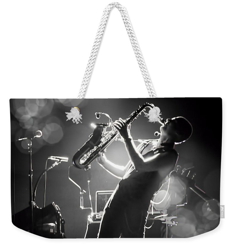 Saxophonist Weekender Tote Bag featuring the photograph Sax In Black by Alice Gipson