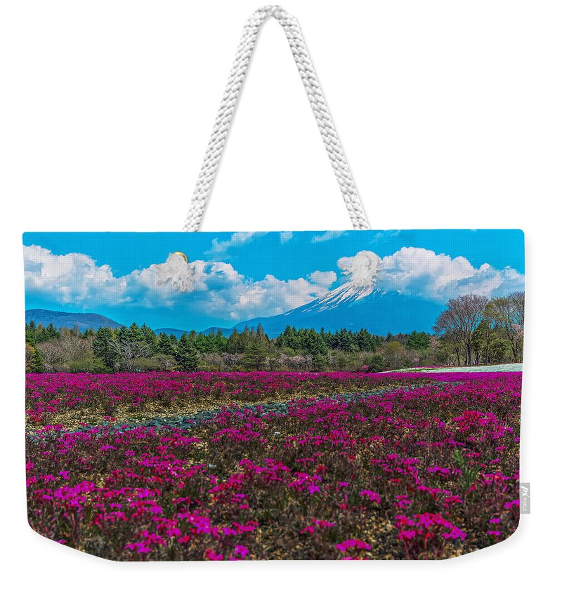 Scarlet Flame Weekender Tote Bag featuring the photograph Scarlet Flame by Jonah Anderson